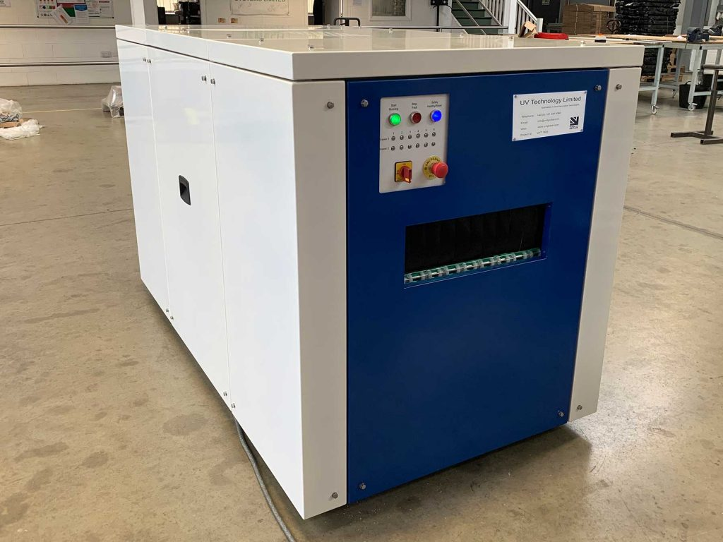 uv-c disinfection tunnel for security trays